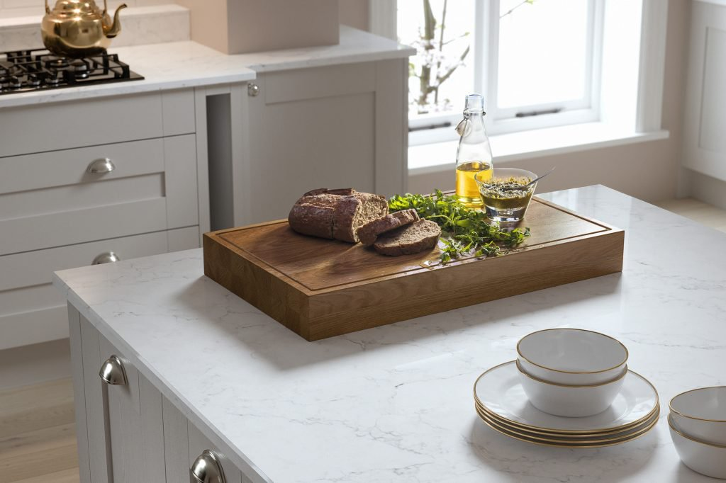 Light shaker kitchen with chopping board