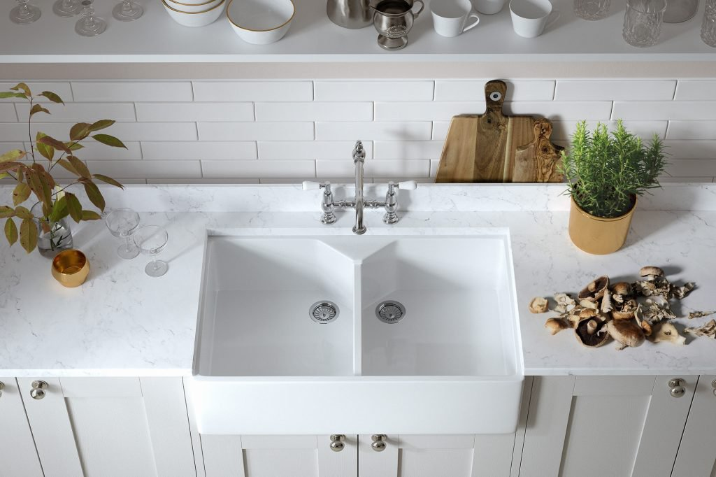 Light shaker kitchen units with undermounted Belfast sink